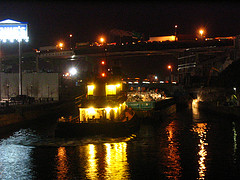 Trash Barge Being Shuttled Through The Waters Of The Gowanus Canal In Brooklyn