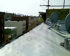 Satellite Dishes On The Roof Of A Building On Clay Street In Greenpoint, Brooklyn