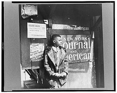 A Young Boy Poses For A Picture In Harlem