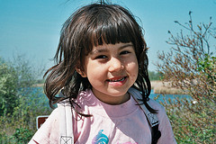 Portrait Of Smiling Child Wearing Backpack, Jamaica Bay Wildlife Refuge