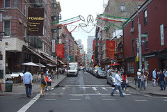 People Pass Through The Streets In Little Italy.