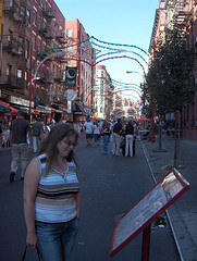 A Woman Studies A Outdoor Restaurant Menu In Little Italy, Manhattan