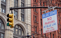 View Of No Parking Sign And Stop Light In Front Of Brick Buildings In Lower Manhattan