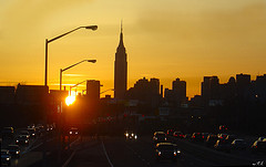 Cars Stream Towards And Away From Manhattan Under Glorious Sunset