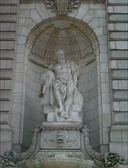 A Photo Of Big Statue Situated At The Entrance Of New York Public Library