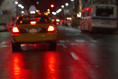 On The Road Behind A Yellow Taxi In Midtown Manhattan