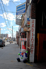 Radiator/ac/check Cashing Shop In Queens; Ridgewood Is A Neighborhood In The New York City Borough Of Queens