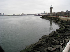 The Roosevelt Island Lighthouse At The End Of The Island, With Randall's Island In The Distance