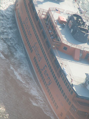 A View From Above Of The Staten Island Ferry On The Water.