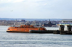 Staten Island Ferry On An Early Spring Day With Ellis Island And New Jersey In The Background