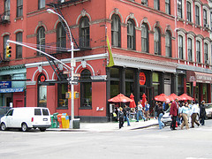 Pedestrians Pass In The Street In Front Of Tribeca.