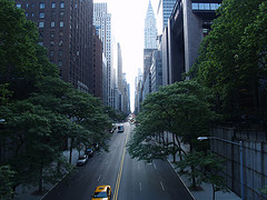 Cars Pass In The Street On A Sunny Day In Tudor City.