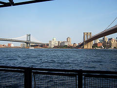View From Water Of Two Bridges Going Into Manhattan.