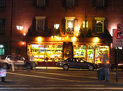 A Bustling Street In Front Of A Restaurant In West Village.