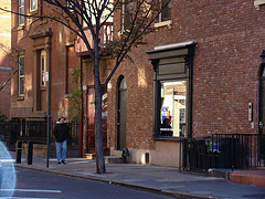 A Woman Passes By A Building In The West Village.
