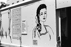 Black and White Shot Of A Pretty Mexican Woman Painted On The Side Of A Taco Truck In Williamsburg, Brooklyn
