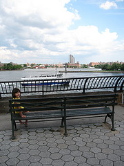 Eden, Like The Title Character Of Harriet The Spy, Watches A Boat On The East River From Carl Schurz Park.