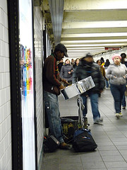 A Street Performer In The Subway Station Of 42nd Street.
