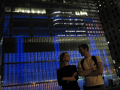 A Young Couple Gaze At One Another In Front Of 7 World Trade Center