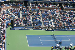 People Are Watching A Game In Arthur Ashe Stadium
