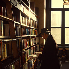 A Reader Browses At Union Square's Barnes & Noble