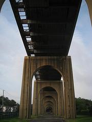 Walking Under The Bayonne Bridge On A Cloudy Day