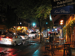 A View Of Nyc's Bleecker Street At Night, As Seen From The Indian Bread Co