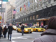 People And Cars Pass In The Street In Front Of Bloomingdales