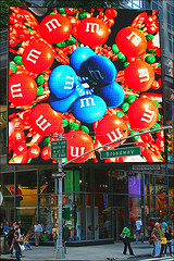 M&m's Video Advertisement Playing Over Sidewalk On Broadway.