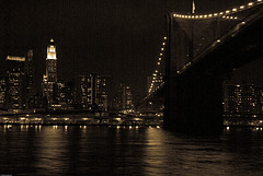 Nighttime Water View Under The Brooklyn Bridge