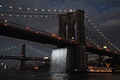A Night Shot Of The 5,989 Foot Brooklyn Bridge On A Cloudy Evening.