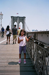 Walking Across The Brooklyn Bridge On A Beautiful Summer Day.