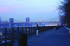 Person Relaxing At Brooklyn Bridge In The Evening