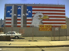 A Large Poster On The Side Of A Building, The Brooklyn Eagle.