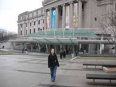 A Woman Poses For A Picture In Front Of Brooklyn Museum.