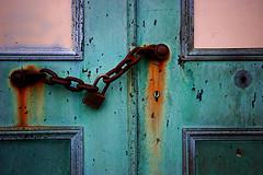 A Rusty Door To The Calvary Cemetery Entry Way.