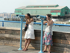 Female Tourists Enjoying Chelsea Piers On The West Side Of Manhattan.