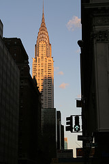 The Chrysler Building Can Be Seen Over The Tops Of Other Buildings.