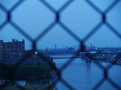 View Of The City Island Bridge Through A Chain Link Fence.