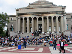 Students Relax In The Sun On The Steps Of Low Library At Columbia University