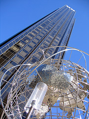A Light, Steel Globe, And A Skyscraper In Columbus Circle.