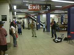 Entertainers Playing In The Subway At Delancey Street On Manhattan's East Side.