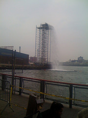 It's An Overcast Day As Onlookers Observe The Waterfall At The East River