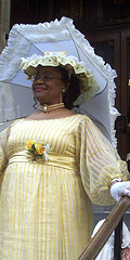 Dressed In Splendid Gown And With Parasol, Attending The Easter Parade