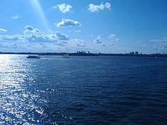 Ellis Island On A Sunny Day Its  Located At The Mouth Of The Hudson River.