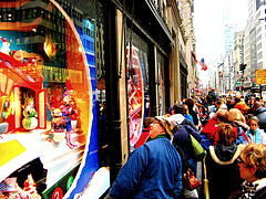 Potential Customers Window Shopping On 5th Avenue In The Borough Of Manhattan.