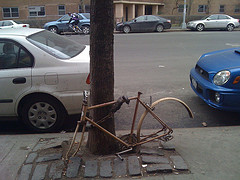 Disassembled Bike Locked To A Pole On First Avenue On The East Side Of Manhattan.