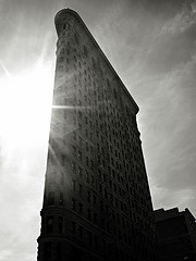 Photo Of The Flatiron Building In The Sunlight On A Cloudy Day