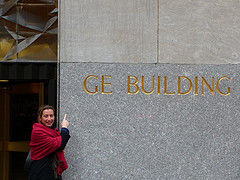 Pointing At The Sign On The Gem Building.