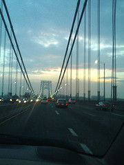 Driving Over The George Washington Bridge As The Sun Sets.